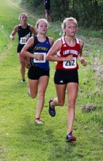 Chloe Scheiber (front), a junior on the Huntington North High School girls' varsity cross country team, leads two other runners down a hill toward the end of the Huntington North Invitational, held Saturday, Aug. 20, on the Huntington University Cross Country Course. Scheiber led the Lady Vikings with a 23rd-place showing in 21:09.3.