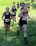 Huntington North's Hannah Stoffel (right) tries to stay a step ahead of Warsaw's Mia Beckham during the Huntington North Cross Country Invitational, held Saturday, Aug. 22, at the Huntington University Cross Country Course.