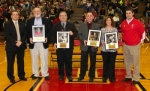 The Huntington North High School Athletic Department inducted four new members to its hall of fame following a boys' junior varsity basketball game at the school on Friday, Feb. 27. Accompanied by Athletic Director Michael Gasaway (far left) and Principal Chad Daugherty (far right), the inductees are (from left) Don Martin, Pete Eckert, Joe Santa and Marcy Hiner Faurote.