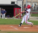 Thomas Parker, a senior on the Huntington North High School varsity baseball team, smacks a double in the first inning of a game against visiting Leo on Friday, May 13. Parker's hit plated junior Carson Wright for the first score of the game, which the Vikings went on to win, 12-4.