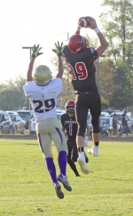 Huntington North junior Garrett Heaston goes high to snag a pass in front of a Marion defender in the Vikings' 36-28 win on Friday, Aug. 21, at Kriegbaum Field.