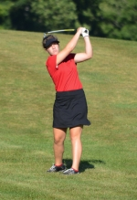 Huntington North High School golfer Crosley Stanley watches an iron shot fly at the Huntington North Invitational on Wednesday, Aug. 3, at Norwood Golf Course.