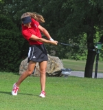 Huntington North High School sophomore golfer Amara Eckert smashes an iron on the first hole at Norwood Golf Course in action against visiting East Noble on Tuesday afternoon, Aug. 16. The Lady Vikings won.