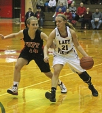 Huntington North's Ellie Lawson (right) takes the ball upcourt with Rileigh McTagertt, of visiting Jefferson, in close pursuit during a game on Friday, Jan. 23.