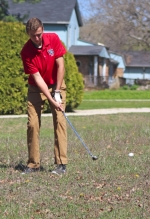 Jared Smith, a junior on the Huntington North High School boys' varsity golf team, chips the ball of the 11th hole at Norwood Golf Club during the Huntington North Invitational on Saturday, April 23. The Vikings placed third at the invite with a 336.