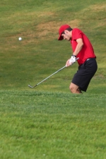 Jacob Vinson, a senior on the Huntington North High School boys' golf team, chips onto the green on the 11th hole at Rozella Ford Golf Club during the Warsaw Boys' Golf Sectional on Friday, June 3. The Vikings placed seventh with a score of 324 and fell short of qualifying for regionals.