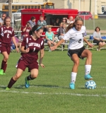 Lady Viking sophomore Karmen Koch maneuvers with the soccer ball against a Columbia City defender on Tuesday, Sept. 1. Koch scored two goals as the Lady Vikes defeated the visitors, 7-0.