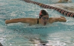 Huntington North freshman Allie Aschliman strokes to victory in the 100-yard butterfly against East Noble on Tuesday evening, Nov. 29, at the Parkview Huntington Family YMCA.