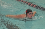 Huntington North senior Cassidy Butler swims to third place in the 100-yard butterfly in swim team action against Bluffton at the Parkview Huntington Family YMCA on Tuesday, Nov. 17.