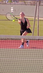 Huntington North's first singles player, Jessica Henline, returns a shot in her match against Mya Diffenderfer on Tuesday, April 25, at the HNHS tennis courts. Henline won her match but the Lady Vikes got edged, 2-3.