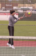 Huntington North third singles player Tarah Zumbrun raises up on her toes as he hits a backhand against Kelsey Dohrman of Bellmont in action at the HNHS tennis courts on Tuesday, May 2. Zumbrun won but the Lady Vikes lost.