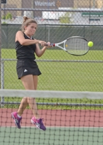 Huntington North High School's second singles player, Katie Hunt, gets on her tiptoes to return a shot to Homestead's Katie Stephens in action Wednesday afternoon, May 11, at Huntington North. The Lady Vikings lost, 1-4.
