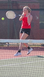 Emily Karst, a junior on the Huntington North girls' varsity tennis team, slaps the ball back to her opponents from visiting Marion during her No. 1 doubles match with senior Ana Eckert on Thursday, April 23. The Lady Vikings lost, 0-5.
