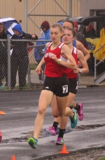 Huntington North girls' track members Alena Miller (left) and Kyler Hoopingarner (right) compete in the 1,600-meter run at the Lime City Relays on Saturday, April 29, at Kriegbaum Field. The Lady Vikings placed fifth at the meet.