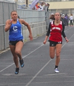 Huntington North freshman Brooke Goodrich (right) strains for the finish line in the preliminaries of the 100-meter dash at the Lime City Relays on Saturday, April 29, at Huntington North.
