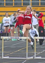 Huntington North sophomore Karmen Koch flies over a hurdle during a third place effort in the 300-meter hurdles at the New Haven Girls' Track Sectional on Tuesday, May 17. The performance earned Koch a trip to regional next week.