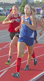 Huntington North senior Hannah Stoffel (left) hangs just off the right shoulder of Homestead runner Grace Walter in the early going of the 1,600-meter run at the Marion Girls' Track Regional on Tuesday, May 24. Stoffel placed third to qualify for state in the event, and the senior won the ,3200-meter run to qualify in that event as well.