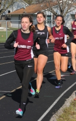 Abbey Ness (second from left), a junior on the Huntington North girls' varsity track and field team, is sandwiched between Columbia City runners while competing in the 800-meter run during the Lady Vikings' meet against the visiting Lady Eagles on Thursday, April 24. Ness finished third and Huntington North won the meet, 78-54.