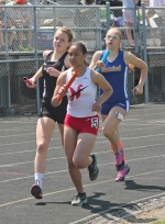 Huntington North's Hannah Stoffel (left) runs the anchor leg of the 3,200-meter relay on Saturday, May 2, at the Lime City Relays at Kriegbaum Field. Stoffel and company placed second in the race as the Lady Vikings finished third as a team in the nine-squad field.