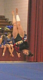 Bailey Harris, a freshman on the Huntington North High School gymnastics team, goes upside down as she executes her routine in the floor exercise during the Concordia Lutheran Sectional on Saturday, Feb. 25. Harris scored an 8.900 to place 19th in the event.