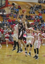 Huntington North's Hunter Hollowell is fouled while going to the basket in action at Mississinewa on Saturday night, Nov. 28. the Vikings won big, 74-37.