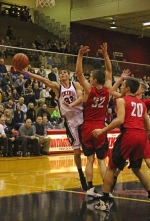 Huntington North High School basketball player Zach Daugherty stretches out to get off a shot in traffic against visiting DeKalb on Saturday night, Jan. 28. The Vikings came up with a big 45-22 win.