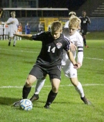 Austin Kaylor (left), a senior forward on the Huntington North High School boys' soccer team, maneuvers the ball with a Homestead defender on his heels during a semifinal game in the Homestead Sectional on Wednesday, Oct. 7. The Vikings' season came to an end with a 1-0 loss.