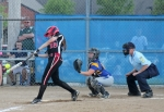Alyssa Voght (left), a freshman on the Huntington North softball team, smacks a double, bringing home three runs in the bottom of the fourth inning of the Homestead Sectional Championship Game, against Homestead, on Thursday, May 28.