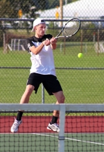 Huntington North tennis player Dane Eherenman hits a back-hander during the No. 2 doubles match against visiting Norwell on Tuesday, Sept. 20. Eherenman and his partner, Brent Kreiger, won a three-setter to help the Vikings notch a 3-2 win.