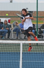 Huntington North's Brent Kreiger lays a good hit on the ball during action at No. 2 doubles vs. Adams Central in the first round of the Norwell Boys' Tennis Sectional on Thursday, Sept. 29. Kreiger and partner Dane Eherenman lost 4-6, 7-6, 4-6 and the Vikings fell 2-3, ending their season.