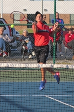 Nick May, a junior on the Huntington North High School boys' tennis team, pops up to hit the ball during his match at No. 1 singles versus Bellmont's Austin O'Campo in the first round of the Norwell Sectional on Wednesday, Sept. 30. May won, 6-1, 6-0, but the Vikings lost, 2-3, to see their season come to an end.