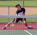 Huntington North's No. 2 singles player Auden Eckert strains to return a shot in his match against Evan Bamgardtner of Bluffton on Tuesday, Auyg. 23. Eckert and the rest of the Vikings won all the matches on the day.