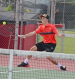Huntington North High School sophomore Auden Eckert puts on the brakes and returns a shot to Warsaw's David Homme in their second singles match on Wednesday, Aug. 19, at HNHS. Eckert won but the Vikings fell, 2-3.