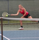 Ana Eckert, a senior on the Huntington North girls' tennis team, extends for the ball during her match at No. 2 singles against Carroll's Jenna Jackson at the Carroll Regional on Wednesday, May 27.