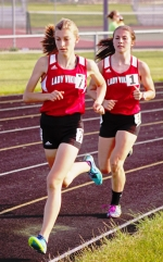 Lady Viking runners Alena Miller (left) and Kyler Hoopingarner compete in the 1,600-meter run at the New Haven Girls' Track Sectional on Tuesday, afternoon, May 16.