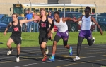 Huntington North's Ricky Haught (first from left) accepts the baton from teammate Zach Baldridge (second from left) to run the anchor leg of the 400-meter relay at the New Haven Boys' Track Sectional on Thursday, May 19. The Vikings clocked in at :45.22 for fourth place, and earned an at-large regional-qualifying spot.