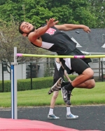 Devon Rooney, a freshman on the Huntington North boys' junior varsity track and field team, twists over the bar in high jump during the 9/10 Invitational on Saturday, May 16, which the Vikings hosted.