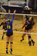 Josi Barscz (right), a junior on the Huntington North High School volleyball team, goes up for a kill while Homestead's Haidyn Carrico (left) elevates to block it during a match in the opening round of the Muncie Central Sectional on Thursday, Oct. 20. The Lady Vikings won, 3-1, and move on to face Muncie Central in the sectional semifinals on Saturday, Oct. 22.