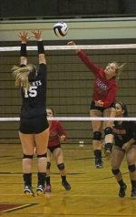 Huntington North High School sophomore Kalee Platt (right) smacks the ball over the net while Taylor Lahee, of visiting East Noble, goes up for the block during a varsity volleyball match on Thursday, Sept. 24. The Lady Vikings won in five sets.