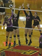 Lady Vikings (from second left) Mackenzi Cannici and Brooke Richison put up a blocking front against Anika Hoffer of New Haven in volleyball action Tuesday night, Sept. 29, at North Arena. The Lady Vikings won in three straight games to improve to 20-5 on the season.