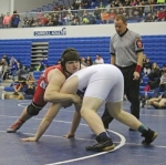 Jerry Gardner (left), a senior on the Huntington North High School wrestling team, has hold of Garrett's Cordell Camp during their opening-round match in the heavyweight division of the Carroll Regional, held Saturday, Feb. 6. Gardner's season came to an end with a 3-2 loss.