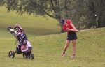 Amara Eckert, a junior on the Huntington North High School girls' golf team, hits an iron shot during the Huntington North Invitational on Saturday, Sept. 16, at Norwood Golf Course. Eckert carded an 82 to help lead the Lady Vikings to the sectional title.