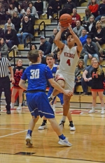 Huntington North guard Deven Newcomb goes up for a shot against Northfield at North Arena on Tuesday night, Feb. 20. The Vikings won, 71-41, to improve to 18-4 on the season.