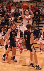 Viking guard Zach Hubbartt drives in on a pair of Bellmont defenders in action Saturday night, Jan. 25, at North Arena. The Vikings won, 57-42.