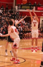 Huntington North High School guard Zach Hubbartt launches a jumper over the Norwell defense on Friday night, Feb. 14, at North Arena. The Vikings lost 49-47 to the 18-1 Knights.