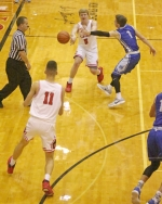 Huntington North's Joe Stoffel (middle) passes to teammate Hank Pulver (bottom left) as Hamilton Southeastern's Nick Bowman attempts to deflect the ball during a boys' varsity basketball game in the Holiday Hoops Tournament on Friday, Dec. 29, at North Arena. The Vikings fell short to the Royals, 45-44.