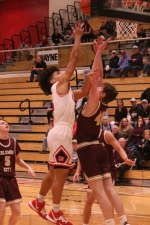 Deven Newcomb (left), a senior on the Huntington North High School boys' basketball team, puts up a shot in the paint during a game against Columbia City in the opening round of the Huntington North Sectional on Tuesday, March 3. Newcomb scored 12 points to help lead the Vikings to a 46-44 triumph.