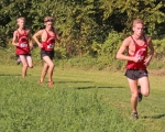 Three members of the Huntington North High School boys' varsity cross country team, (from right) Jarid Miller, Isaiah Clampitt and Harrison Niswander, compete at the Northeast 8 Conference championship meet on Saturday, Sept. 29, at the Huntington University Cross Country Course. The Vikings claimed third place with a score of 90.
