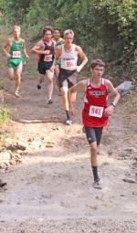 Drew Davis (foreground), a junior on the Huntington North High School boys' varsity cross country team, leads a group of runners across a creek on the Huntington University Cross Country Course during the HNHS Invitational on Saturday, Aug. 19. The Vikings placed fifth out of 16 teams.