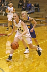 Rileigh Johnson, a senior on the Huntington North High School girls' varsity basketball team, dribbles the ball upcourt during a game against visiting Homestead on Tuesday, Nov. 21. The Lady Vikings fell to the Lady Spartans, 71-45.